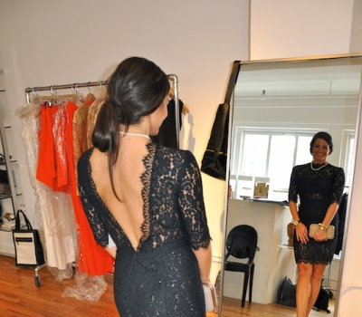 trying on designers dress